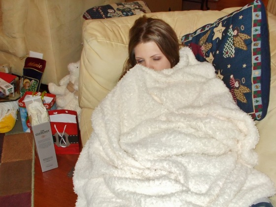 Then Baby Girl is passed out on the couch all wrapped up in her little blanket.  Too cute.